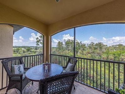 Photo for Fabulous top floor condo in Treviso Bay WITH Golf Membership!