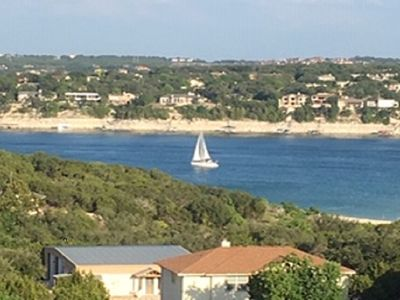 Photo for Home overlooking Lake Travis! Private custom 10 person hot tub, golf, marina...
