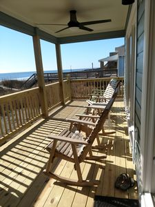 private porch with rocking chairs for beach viewing