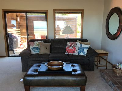 Couch and Ottoman.  Sliding glass door behind leads to BBQ and fenced in deck.