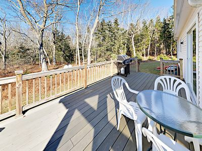 Deck - Fire up the propane grill and dine al fresco at the 3-person table.