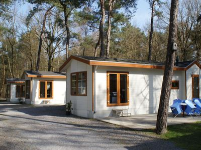 Photo for Comfortably furnished chalets in the woods, on the holiday park De Reebok