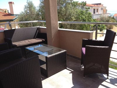 Photo for Two bedroom apartment with terrace and sea view Novalja, Pag (A-6420-a)