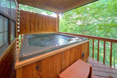 Laze in the outdoor hot tub - When it comes to pampering, it's tough to beat luxuriating in an outdoor hot tub overlooking lush woods.