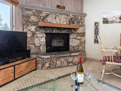 Photo for Inviting condo with lodge atmosphere, wood-burning fireplace and shared hot tub