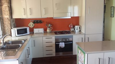 Your modern fully-kitted kitchen with fridge freezer and island cupboards