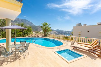 Shared pool and terrace with sea views