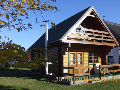Photo for House - wooden planks block house with fireplace
