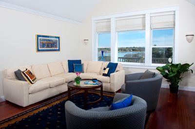 Gather in the living room with views of great salt pond, open to DR and kitchen.