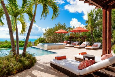 The pool deck and shaded patio offer an exquisite escape