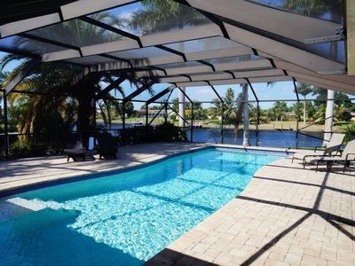 Photo for Casa DeLo - SE Cape Coral 3b/2ba/Den, Oversized 40ft long Elect Heated Pool, Gulf Access Wide Inters