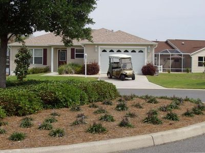 Home and Golf Cart located on a cul-de-sac, nice size yard with new sod.