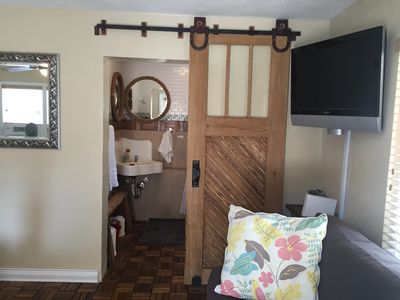 Photo for Bearfoot Beach Bungalow! Walk to beach, river, intercoastal, and Flagler Ave
