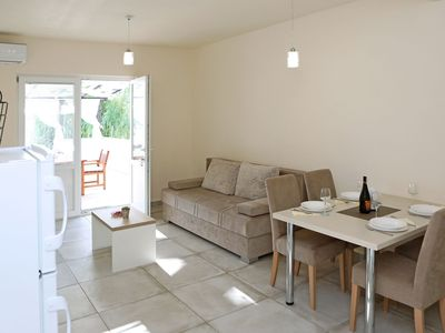 Photo for Modern  ground floor apartment with private terrace only 200m from the sea
