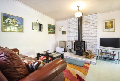 lounge with gas heater and wood burner