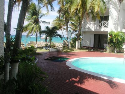 View of pool and private beach