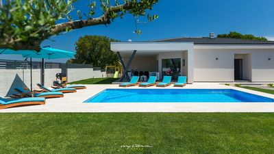 Photo for Modern family villa with pool near the sea