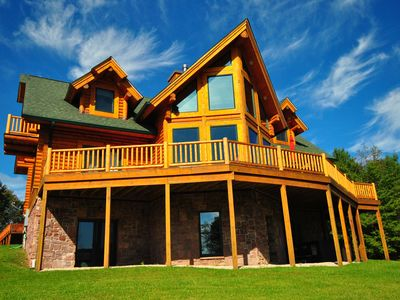 Photo for Stunning 5 Bedroom Log Home with hot tub offers breathtaking mountain views!