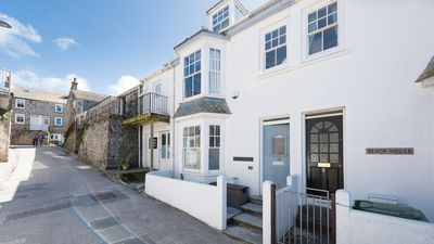 Photo for 1 Porthmeor Road, beach is just 30 seconds away. Super close to St Ives harbour and town too. Free WiFi