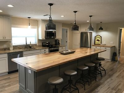 Kitchen with 12 foot island with cypress top