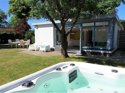 detached beachhouse with private jacuzzi . 15 minute walk tot the beach