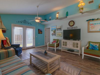 Photo for Family-friendly getaway close to the beach w/ furnished porch & shared pools