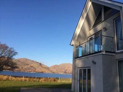 The house with Loch Ailort and the hills in the background.