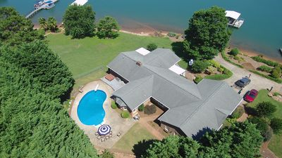 Lake house with pool and dock