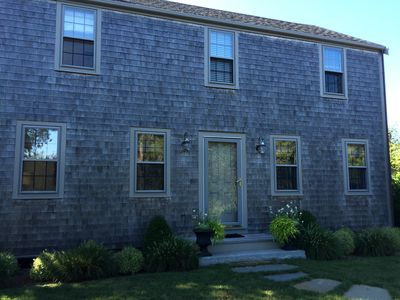 Beautiful, saltbox home with lovely landscaping