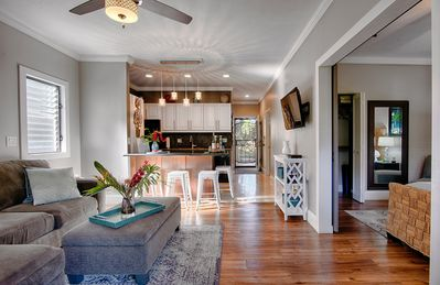 Open living plan and with granite breakfast  bar in kitchen. Modern beachy decor