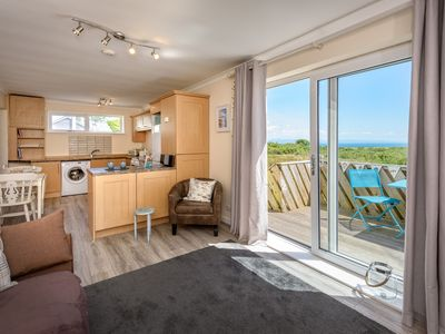 Photo for A lovely couples retreat with far reaching sea and countryside views from the spacious living area a
