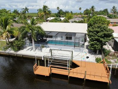 Photo for Enjoy Your Own Private Waterfront Home in Matlacha Isles! Heated Pool, Gulf Access Canal, Free WiFi!