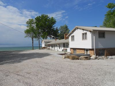 Photo for Newly Remodeled Beach House on the Lake , private deck, 600 ft. of private beach