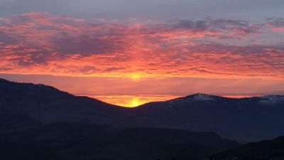 Beautiful sunset view over the mountains right outside the patio! About 30 miles