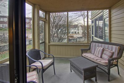Walk-out screened in patio - This screen in patio is perfect to enjoy a nice cup of hot coffee and watch the sun rise or set with your pets!