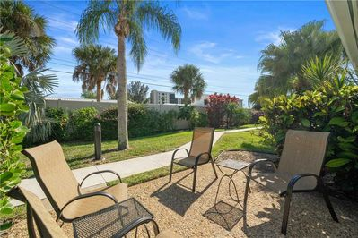 Enjoy Florida natural scenery in your very own backyard! - Lounge, catch up on your latest read, or nap peacefully on the chaise loungers. The Gulf wind rustles the palms and the balmy breeze will wrap around you at any time of the day.