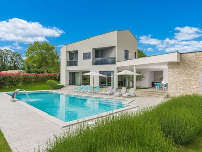 Photo for A modern luxury villa with a crystal-clear swimming pool and cultivated garden