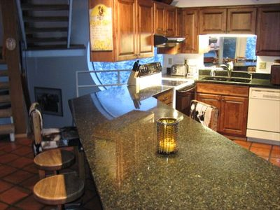New marble counter with seating for 12--new kitchen cabinets.