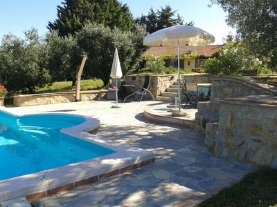 Photo for Small villa on a hill with pool and fantastic views far to the sea