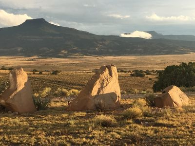 Cerro Pedernal and nearby boulders.  South side of the guest house. late day
