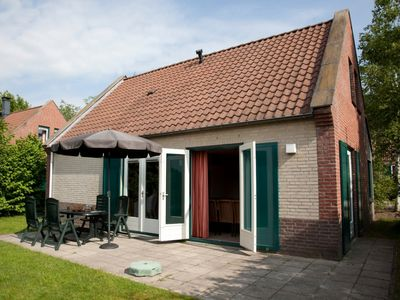 Photo for 8-person terrace house in the holiday park Landal Domein De Schatberg - on the water/recreation lake