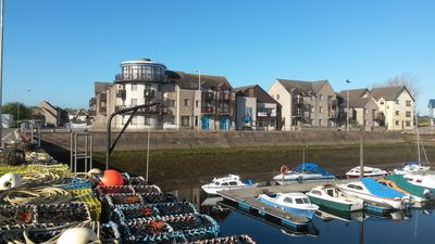 Photo for Nairn harbour-side apartment with stunning ocean views