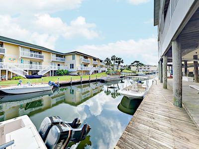 Canal-Side Location - Enjoy views over the canal from your private deck. Home professionally managed and maintained by TurnKey Vacation Rentals.