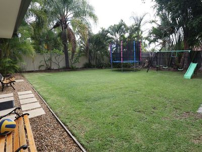 Huge manicured grassed area with play equipment