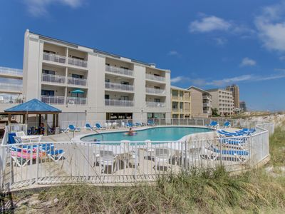 Photo for NEW LISTING! Waterfront condo w/ three shared pools, tennis, & beach access