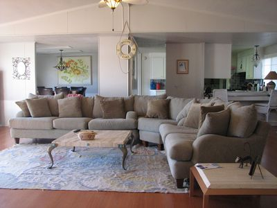Huge, comfy sectional in living room, with expansive view of lake and boathouse.