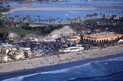Aerial view of shows that you are just steps from the sand and water of both the ocean and the Bay. Notice the old fashioned roller coaster that is close by too.