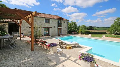 Photo for Stunning Barn conversion with private pool in Champagne-et-Fontaine