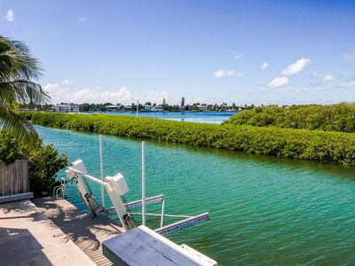Photo for Waterfront w/30-ft dock w/ access to Cabana Club shared pool!