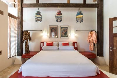 King Bed in bedroom with ensuite, air-con, TV, telephone, safety box and gowns.